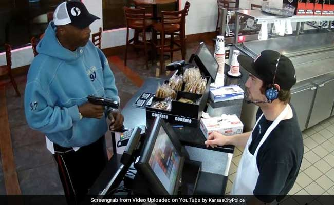 Watch: Cashier Has The Most Calm Reaction To Being Robbed At Gunpoint
