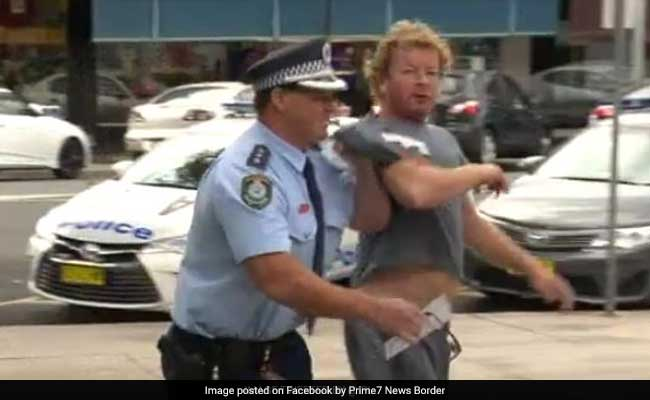 Video: Australian Cop Stops Press Conference To Make An Arrest