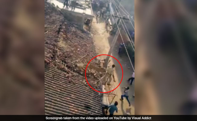 Caught On Camera: Forest Ranger Jumps Off Roof To Escape Leopard