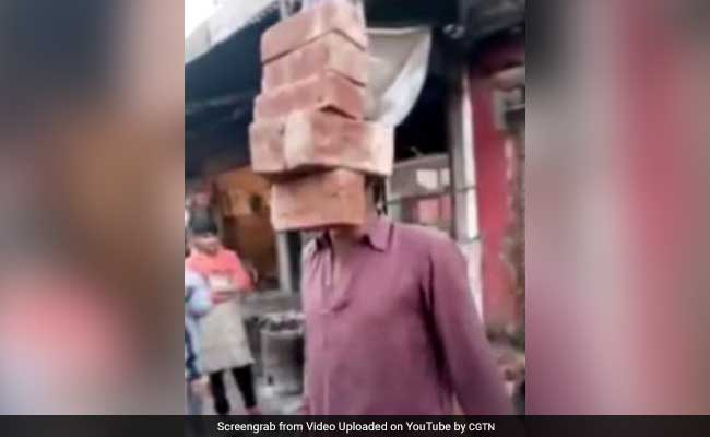 Look Ma, No Hands! Man Lifts 6 Bricks With His Teeth In Amazing Video
