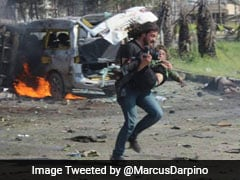 Photographer Puts Down Camera To Save Boy In Syria, Then Breaks Down