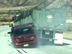 Truck Drags Car Along Highway As Driver Waves For Help