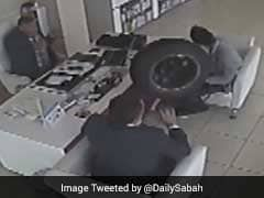 Caught On Camera: Tyre Falls Off Moving Car, Enters Store, Hits Two Men