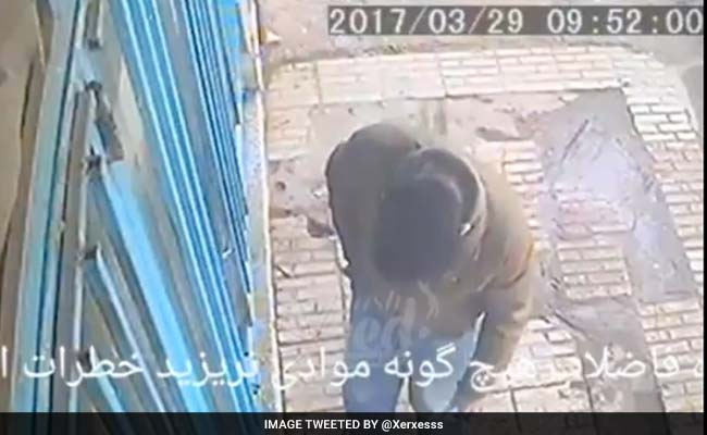 Watch: Sewer Hole Explodes In Man's Face As He Drops Cigarette Butt In It