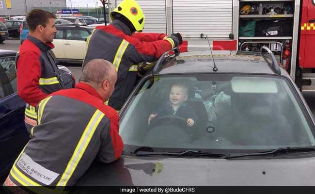 Baby Loves Every Minute Of Being Stuck In Locked Car As Firemen Struggle