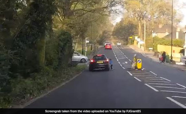 Video Child Crashes Scooter Into Car Helmet Saves His Life