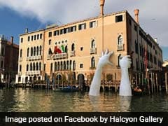 Giant Hands Emerge From The Water In Venice. Find Out Why