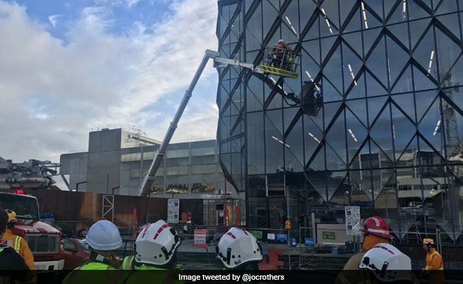 Workers Dramatically Rescued From Crane After Being Stranded Mid-Air