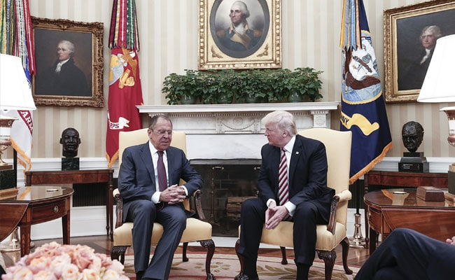 Presence Of Russian Photographer In Oval Office Raises Alarms