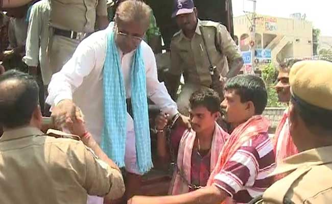 Accused farmers produced in court handcuffed; 2 cops suspended