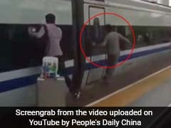 Commuter Runs Along Moving Train With Finger Stuck Between Doors
