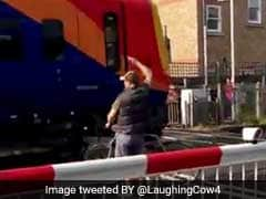 Cyclist Nearly Killed By Train After Squeezing Through Safety Barriers