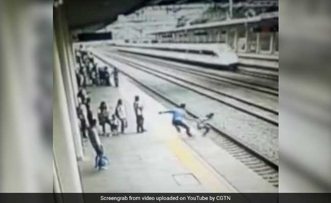 Railway worker saves woman from jumping in front of train