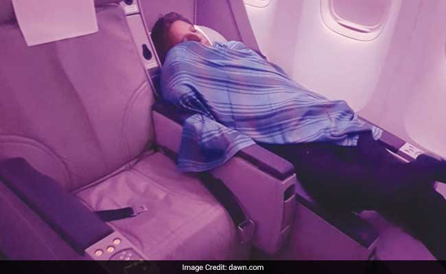 Pakistan International Airlines pilot pictured taking a break in Business Class