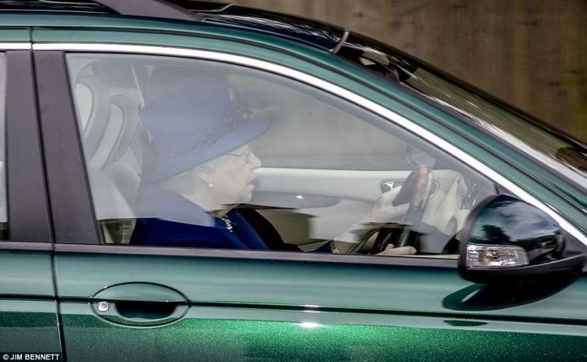 queen elizabeth driving her jaguar