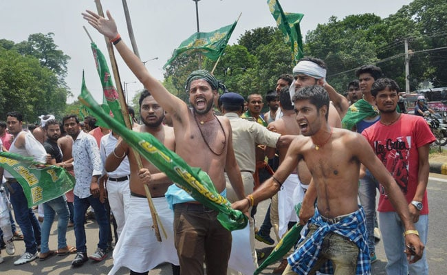 Shirtless Protest By Lalu Yadav's Partymen At BJP Office Day After Raids