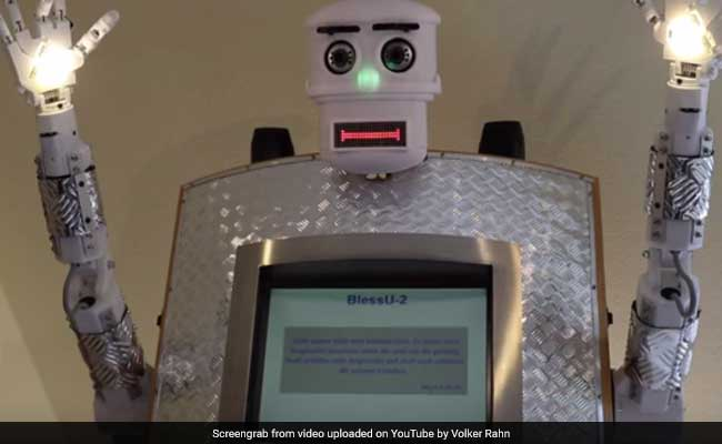 Worshippers in Germany receive blessings from a robot priest