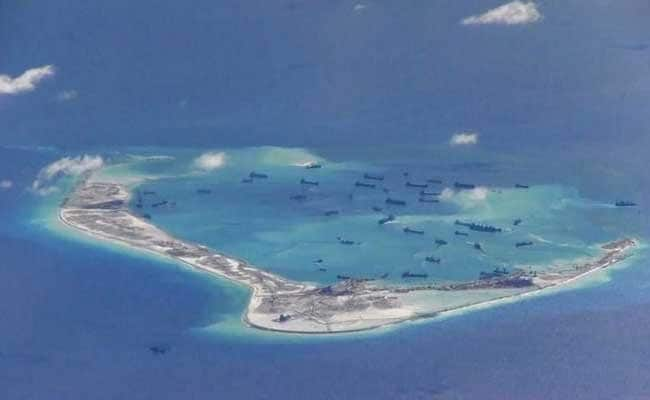 China Still Building South China Sea Islands: Report