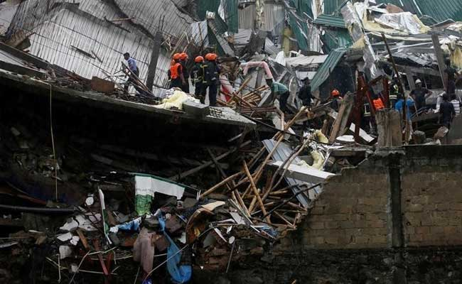 Rescuers Scramble To Save Woman Trapped In Sri Lanka Building Collapse