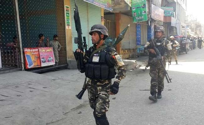 Three Killed, Dozens Wounded As Gunmen Storm Bank In Afghanistan