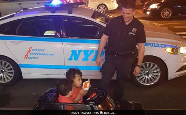 Police Officers 'Pull Over' 2-Year-Old Twins Taking Toy Car For A Joyride
