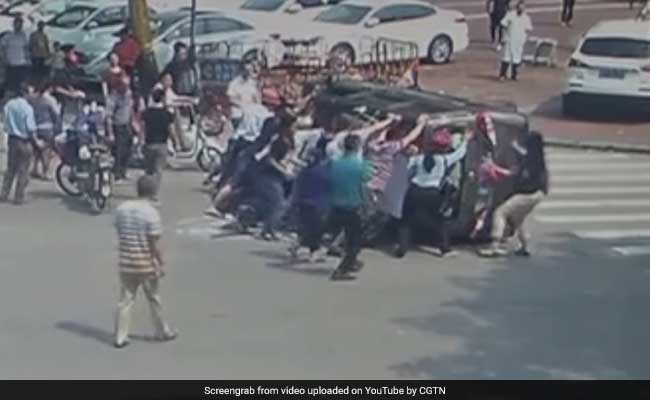 Watch: Bystanders Flip Car Upright After Accident To Save Driver