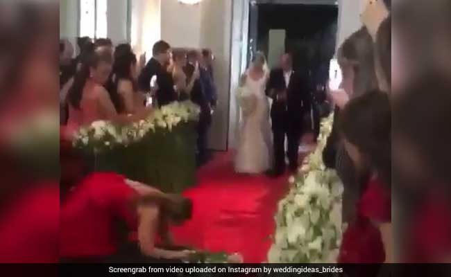 Woman Trips While Taking Bride's Photos. Acts Like Nothing Happened