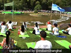 Over 1,000 People Take Part In Yoga Event In China