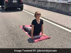 Stuck In Traffic, This Woman Decided To Do Yoga On The Highway