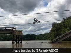Watch: Daredevil Bikers Recklessly Jump Across Partially Collapsed Bridge
