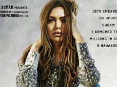 <i>Baadshaho</i> Poster: Esha Gupta Introduced As 'Badass Bombshell'