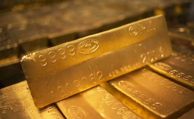 US gold futures for December delivery dropped 0.8% to $1,268.70 per ounce