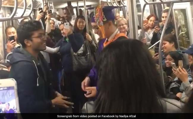 Commuters Throw Impromptu Graduation Party For Student Stuck On Train