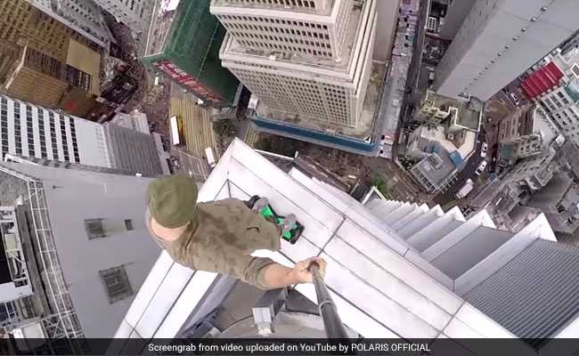 Watch This Daredevil Ride A Hoverboard, Play Basketball On A Skyscraper