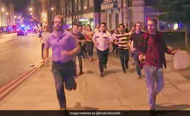 One For The Road? Pint-Clutching Man Becomes Symbol Of London's Defiance