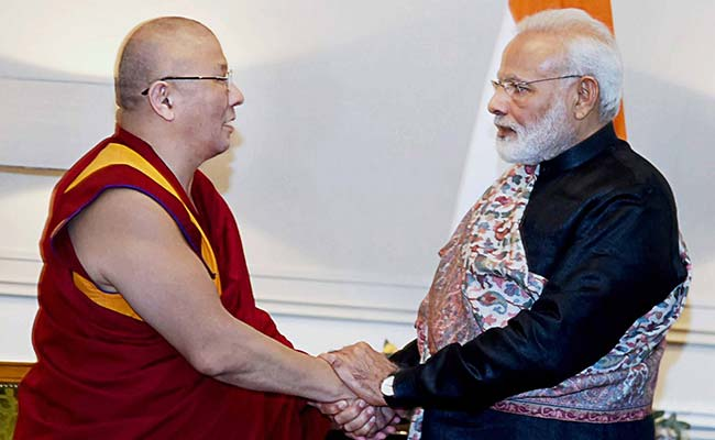 Narendra Modi Gifts Sacred Tibetan Books To Buddhist Temple In Russia