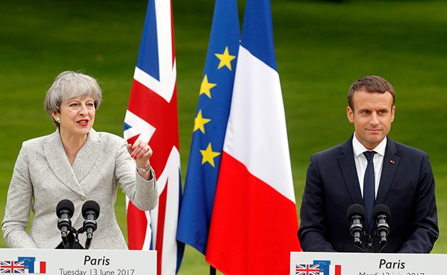 May to attend France-England friendly following attacks in Manchester and London