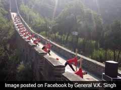 Indian And Chinese Yoga Enthusiasts Practice Poses At Great Wall Of China
