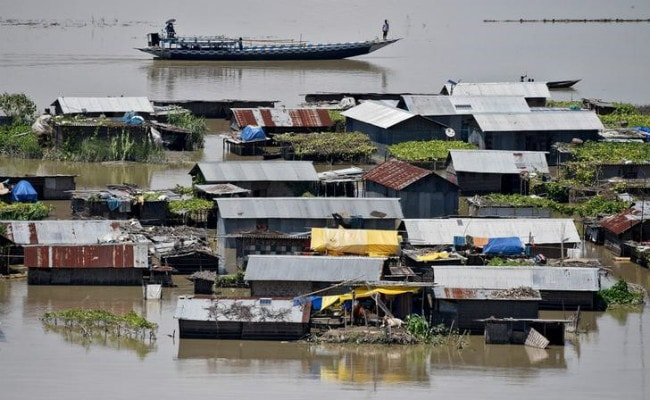 report writing on flood in assam