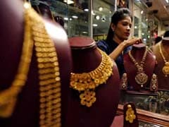 Gold Prices Edge Up As Dollar Eases