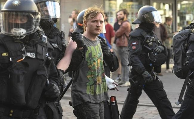 German police officers detain an anti G20 protester in Hamburg