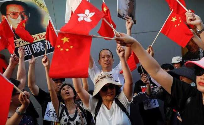 China's President Xi Jinping Talks Tough On Hong Kong As Thousands Protest For Democracy