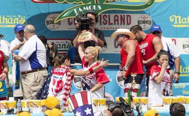 Miki Sudo celebrates after winning. She ate 41 hot dogs in 10 minutes