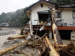 Japan Prime Minister Shinzo Abe Sees Devastation In Flood-Hit Area