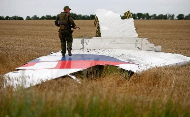 Prosecutors charge four in downing of Malaysia Airlines Flight MH17