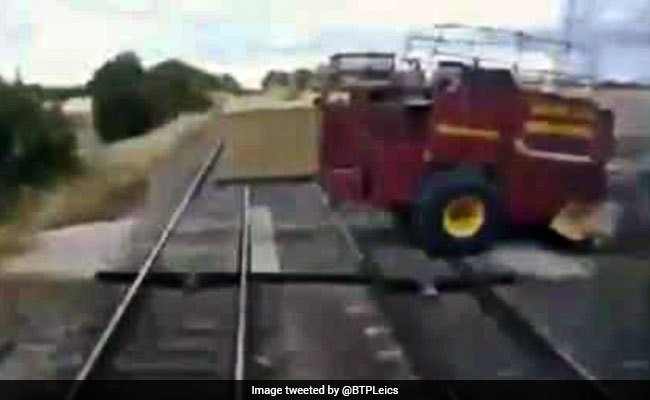 Caught On Camera: Shocking Moment Speeding Train Misses Tractor By Inches