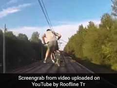 Watch: Cyclists Attempt Riding On Roof Of Moving Train. Nearly Fall Off