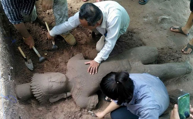 Ancient Statue Unearthed At Cambodia's Angkor Complex