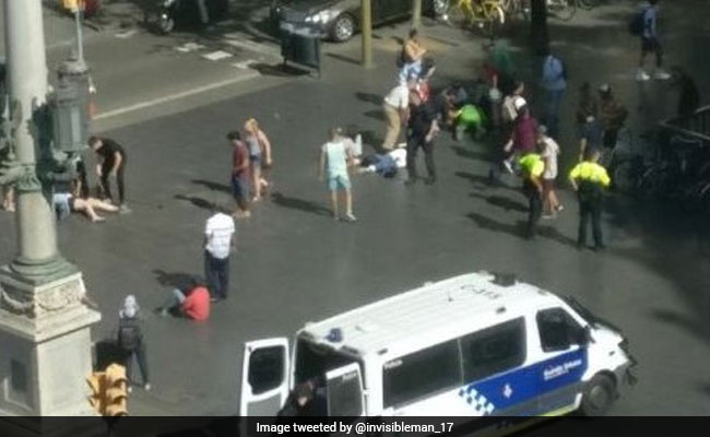At least 13 killed as van rams into crowd in Barcelona