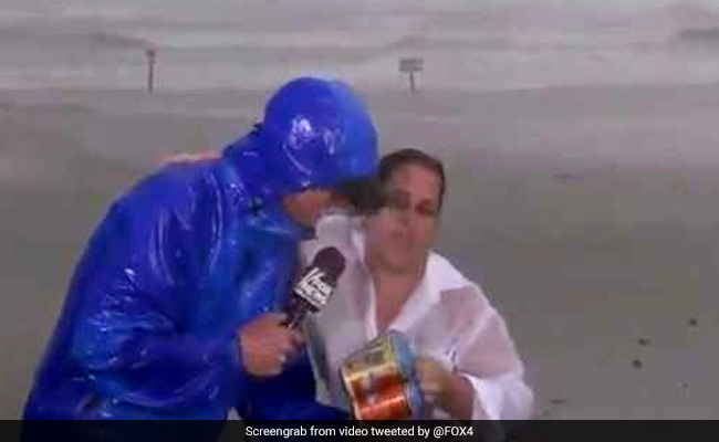 Hurricane Harvey: Woman Interrupts Reporter On Live TV To Hand Him Beers